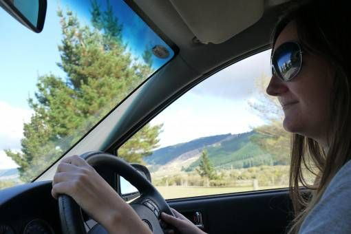 Amy driving in New Zealand