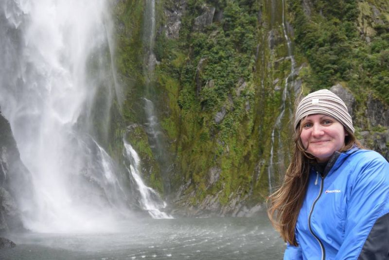 Amy with the waterfall in Milford Sound