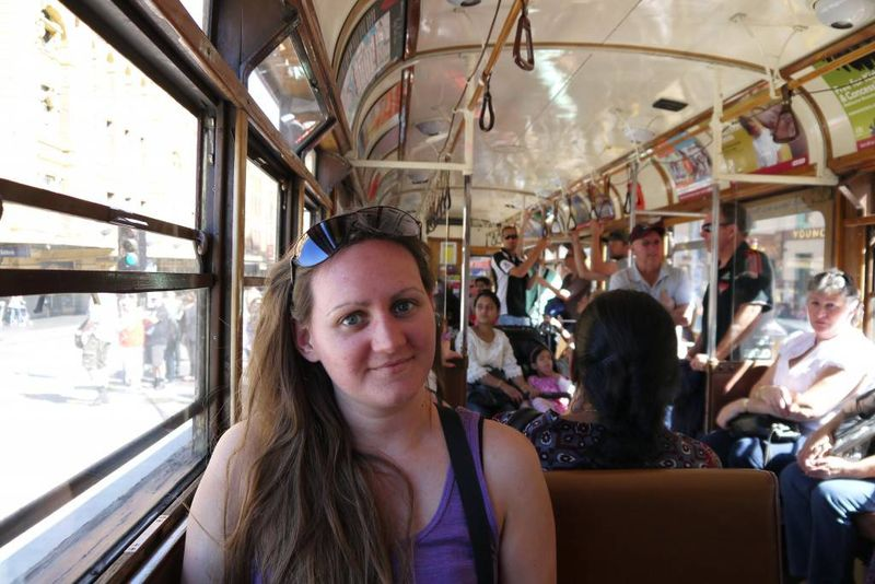 Amy riding the Tram in Melbourne