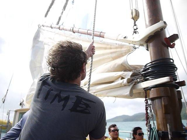 Andrew Hoisting the Sails