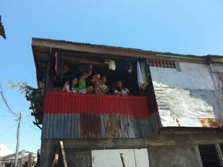 Family in a Damaged House in Tacloban City