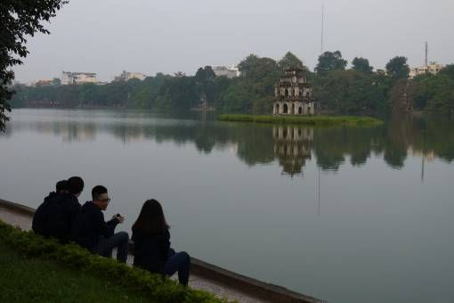 People Relaxing by the Lake in Hanoi, Vietnam
