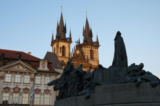 Tyn Church and statues in Prague Old Town Square
