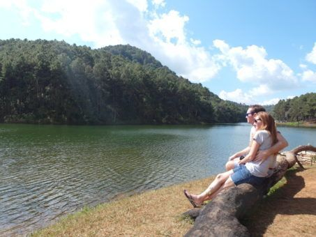Us looking out at Pang Yng resevoir in Thailand