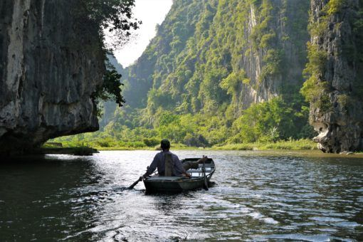 Boatman on the river in Tam Coc, Vietnam