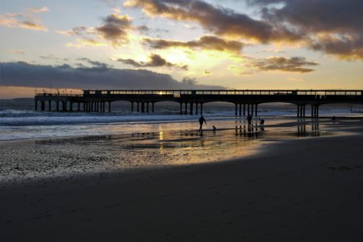 Sunset over Boscombe pier and the sea in Bournemouth, UK
