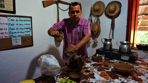 Our guide Eugenio showing us how he gets 100% pure cacao