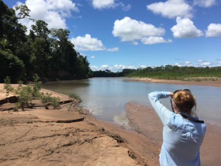 Photographing a river in the Amazon Rainforest in Bolivia, at Madidi National Park