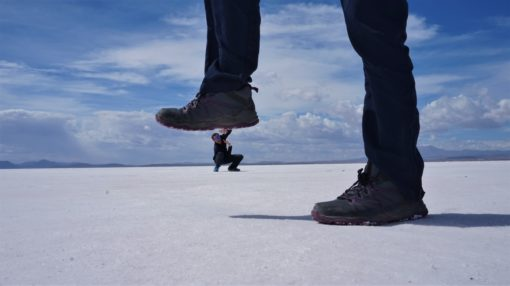 Salt Flats perspective picture - giant foot crushing a little person