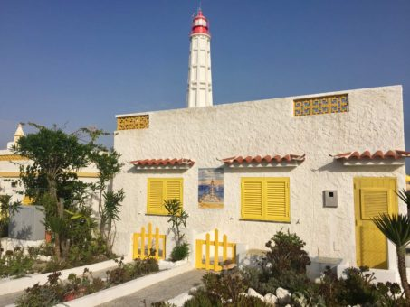 Portuguese cottage and lighthouse on an island in the Ria Formosa Natural Park, Algarve, Portugal
