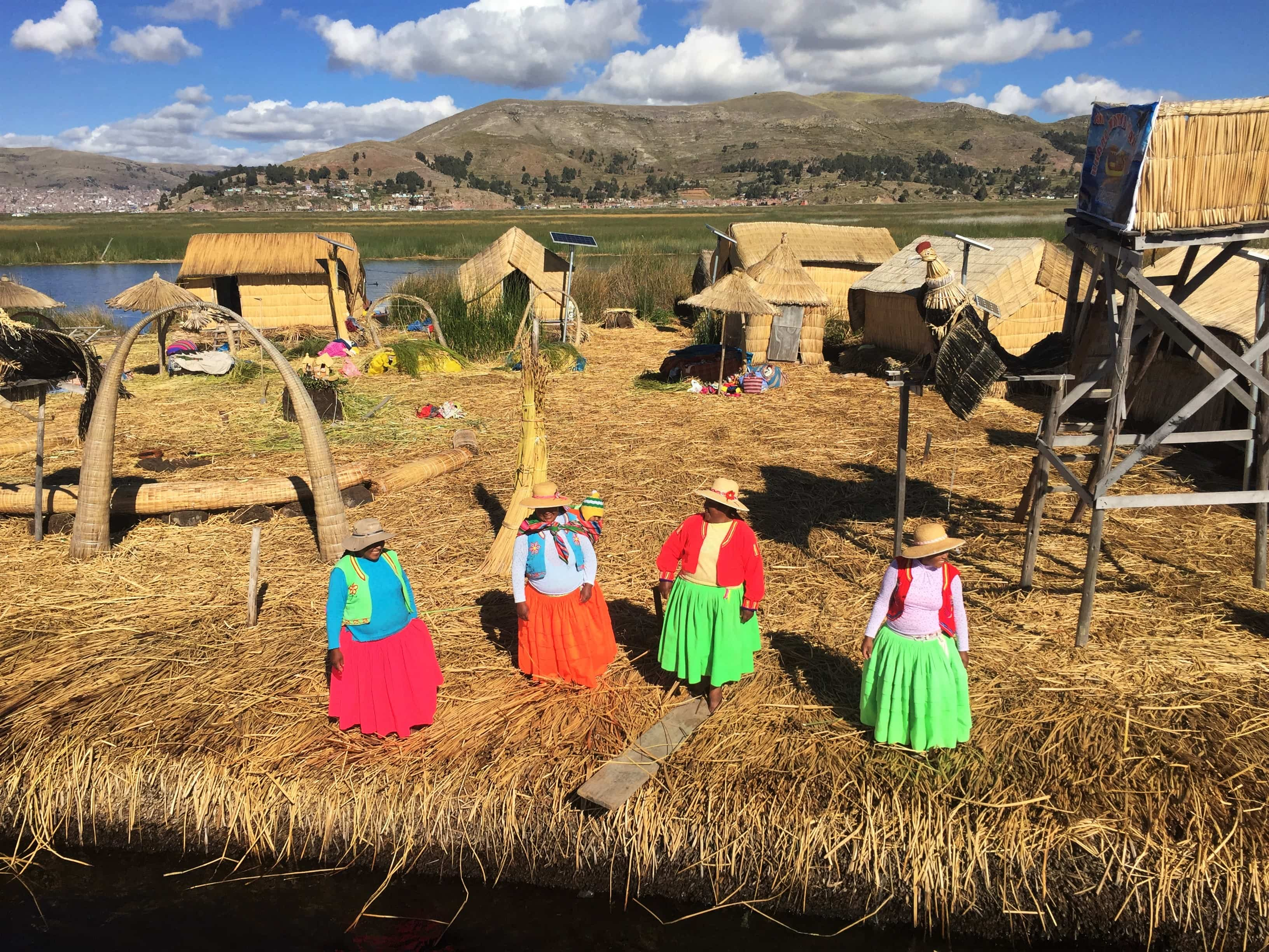 The brightly coloured clothes of the Uros women on the floating islands, Lake Titicaca Trip