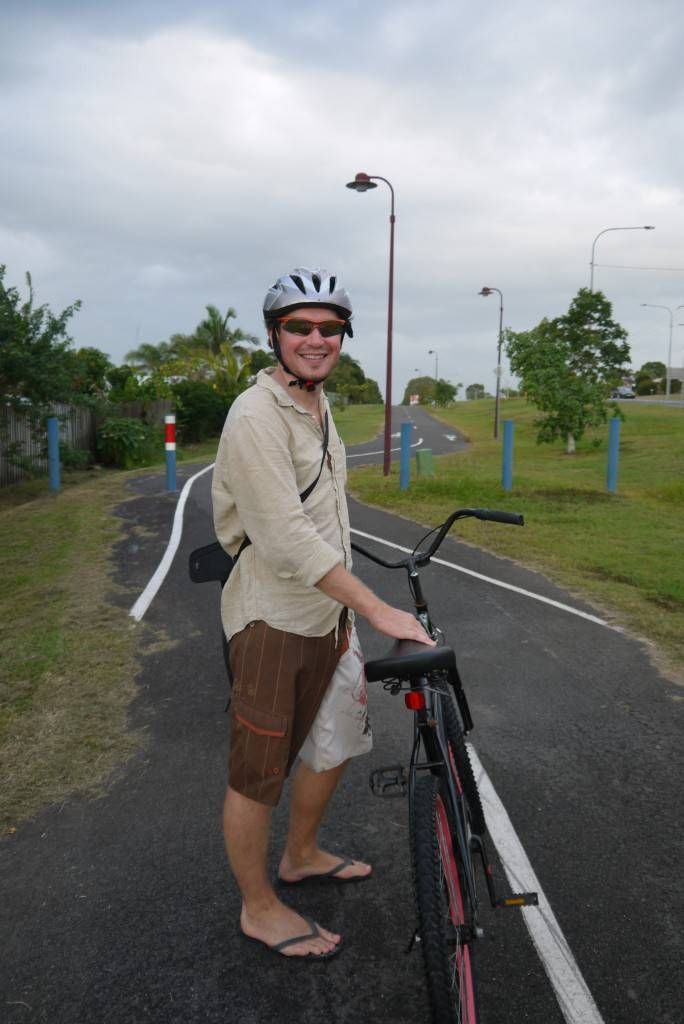 Andrew gets on his bike in Hervey Bay