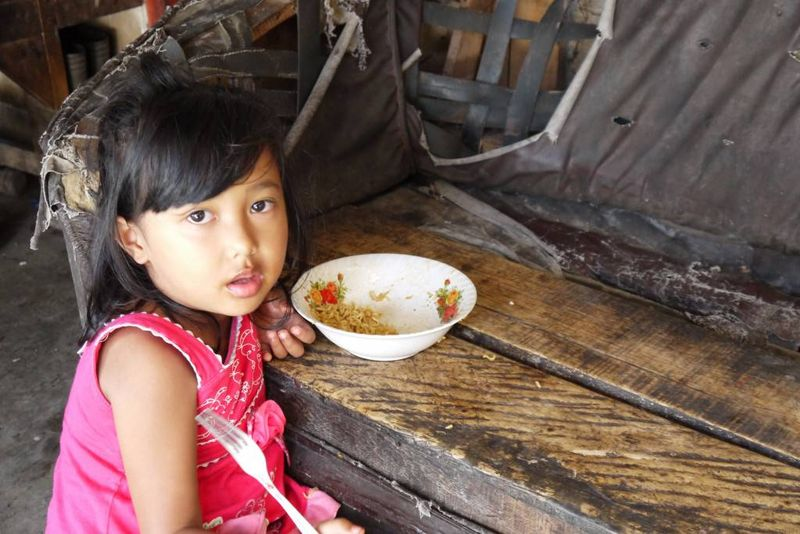 Balinese Child in her Family Compound