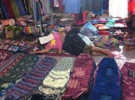 Woman Sleeping at the Market in Laos