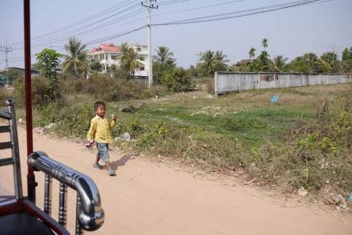 Boy Walking Along the Road in Cambodia