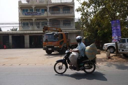Man and Luggage on a Motorbike in Asia