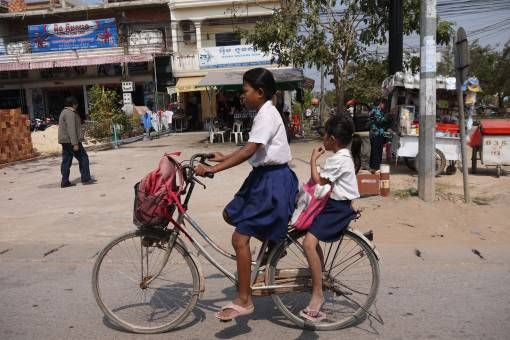 School Girls Riding a Bike in Cambodia