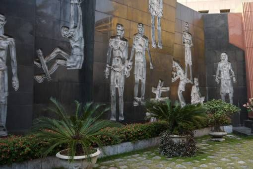 Mural at the Ho Lao Prison Museum in Hanoi