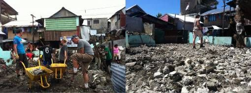 Clearing the remains of a house destroyed by Typhoon Haiyan