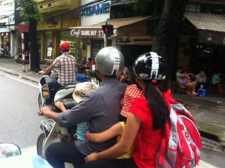 A true family vehicle, four people on one motorbike
