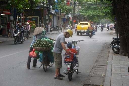 Electric bike, push bike and oranges in Hanoi's Old Quarter