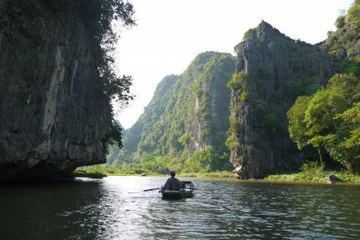 A boat floating down the river in Tam Coc