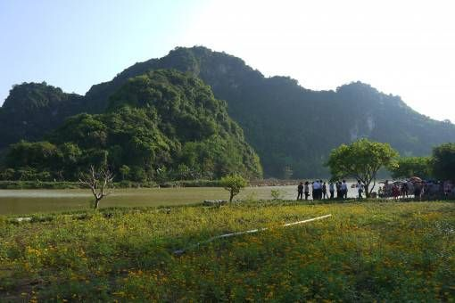 Fields, mountains and river in Tam Coc, Vietnam