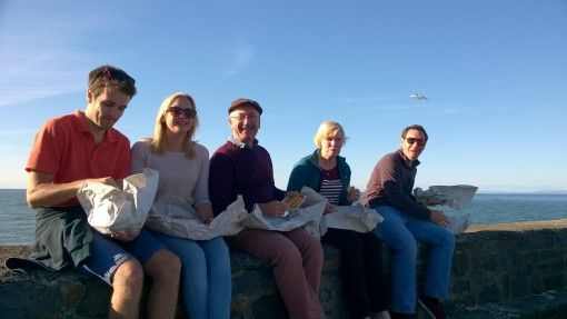 A family Fish and Chips at New Quay, Wales