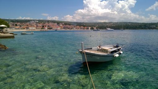 Fishing boat on the clear blue waters of Primosten, Croatia