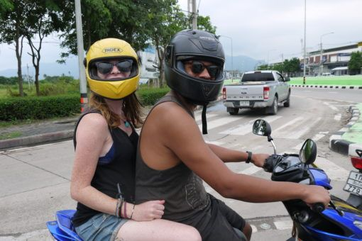 James and Sarah riding a motorbike in Chiang Mai