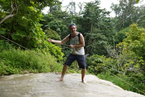 Andrew climbing the Sticky Waterfall, Thailand