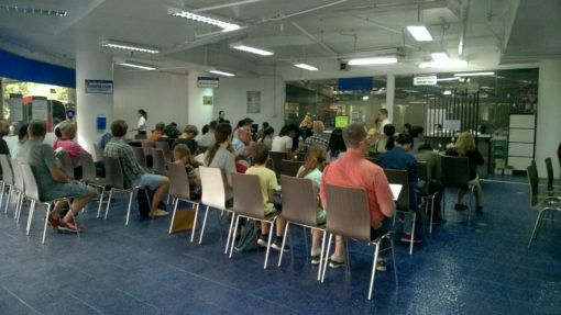 Waiting inside the Chiang Mai Immigration office for our Thailand Visa Extensions