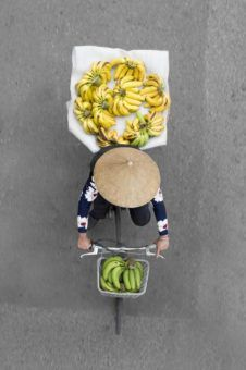 Aerial view of a Hanoi Street Vendor on a bike full of bananas