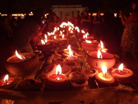 Flickering tea lights at The Three Kings Monument for Yi Peng Festival and Loy Krathong, Thailand