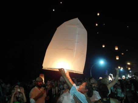 Girl releasing a lantern at Yi Peng festival 2016 in Chiang Mai, Thailand