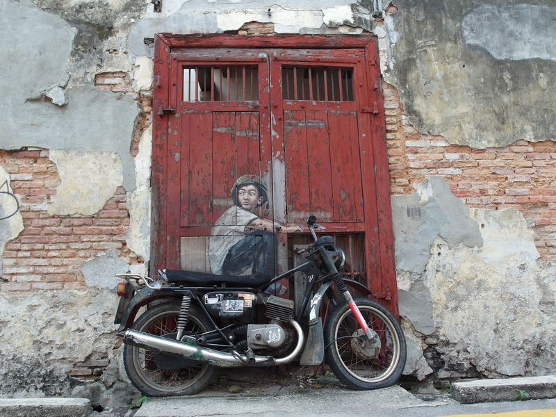 Boy on a motorbike street mural in Penang, Malaysia