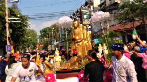 Float carrying Buddha statues in Songkran Parade Chiang Mai
