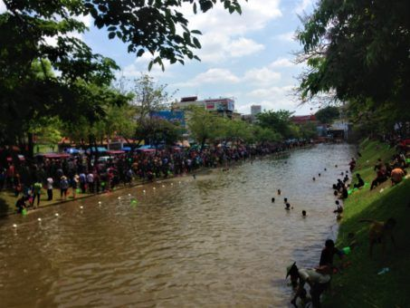 Songkran revellers near the moat in Chiang Mai, Thailand
