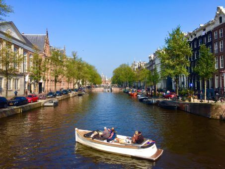 A boat on a canal in Amsterdam, The Netherlands
