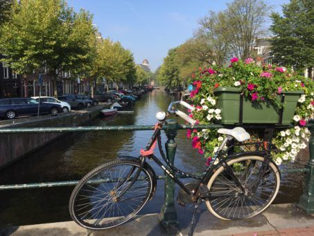 A bicycle by the canal in Amsterdam, The Netherlands