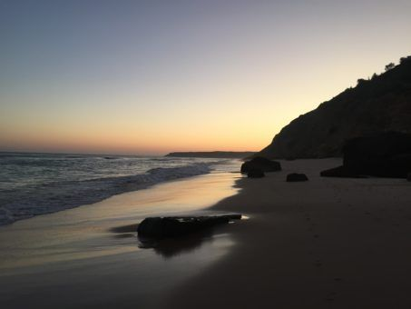 Salema Beach at sunset in the Algarve, Portugal