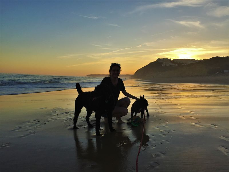 Amy walking the dogs on Salema Beach on the Algarve, Portugal