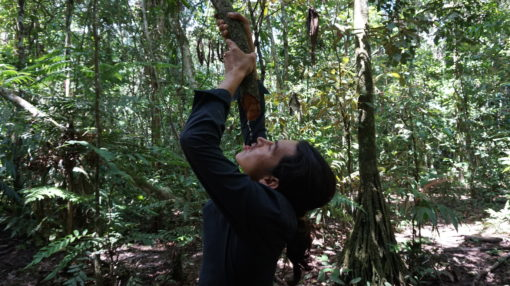 Our guide Cheo drinking water straight from a vine in Madidi National Park, Bolivia
