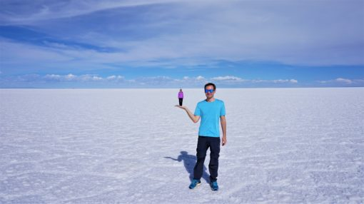 Bolivian Salt Flats Tour perspective shot - large person holding small person on their palm