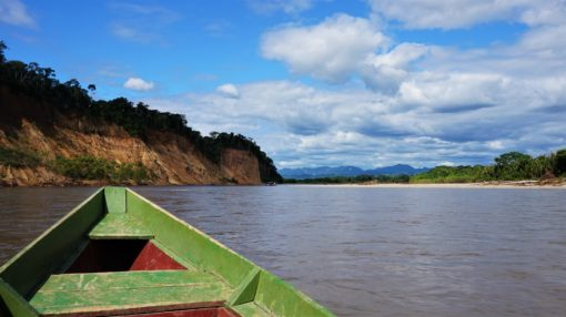 travelling by boat in the Amazon Rainforest