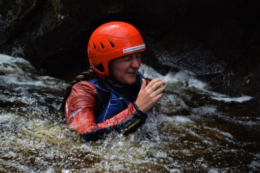 Me in the water after jumping off a cliff on the River Findhorn in Scotland