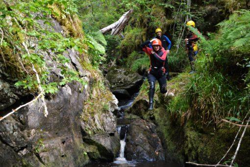 Adventure activities Scotland: doing a cliff jump on a canyoning trip