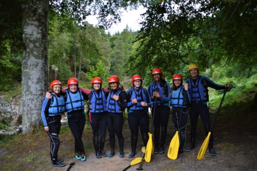 Yoga camp at ACE Adventures preparing to go white water rafting on the River Findhorn