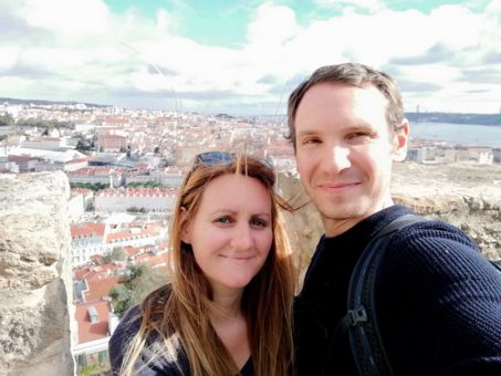 Us at a viewpoint overlooking Lisbon in Portugal