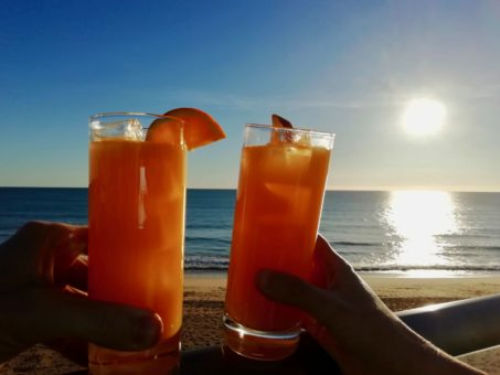 Fresh orange juice overlooking Vale Do Lobo Beach, Portugal